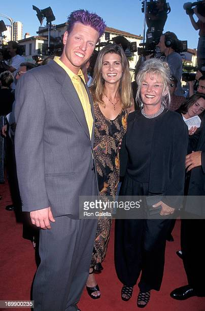 Actor Jake Busey girlfriend and his mother Judy Busey attend the Contact Westwood Premiere on July 1 1997 at the Mann Village Theatre in Westwood...