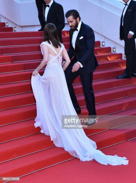 US actor Jake Gyllenhaal and British actress Lily Collins arrive for the screening of the film 'Okja' in competition at the 70th annual Cannes Film...