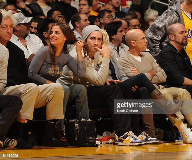 Actor Jake Gyllenhaal and Jeffrey Katzenberg watch a game from courtside between the Portland Trail Blazers and the Los Angeles Lakers at Staples...