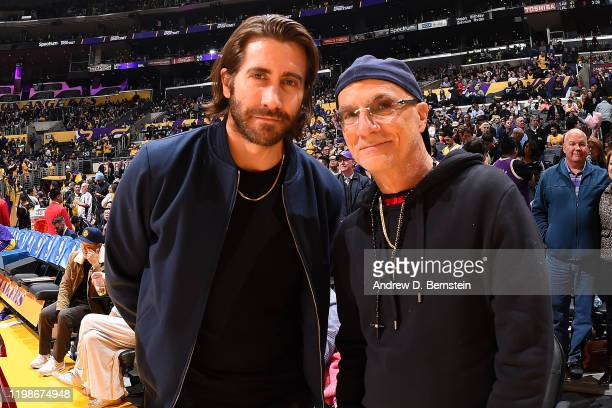 Actor Jake Gyllenhaal and Record Producer Jimmy Iovine pose for a photo during the game between the Los Angeles Lakers and the San Antonio Spurs on...