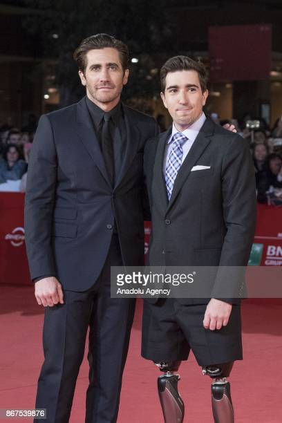 """Actor Jake Gyllenhaal and writer Jeff Bauman , victim of Boston marathon bombing 2013 attend the red carpet of the movie """"Stronger"""" during 12th Film..."""