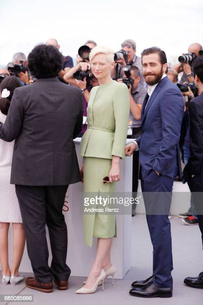 Actor Jake Gyllenhaal Director Bong JoonHo and actress Tilda Swinton attend the Okja photocall during the 70th annual Cannes Film Festival at Palais...