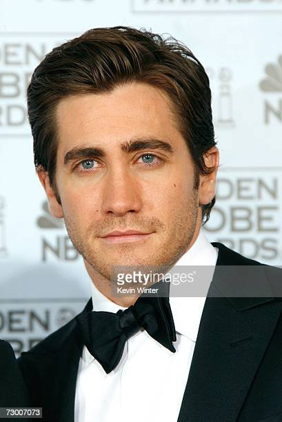 Actor Jake Gyllenhaal poses backstage after presenting writer Peter Morgan with his Best Screenplay Motion Picture award for The Queen during the...