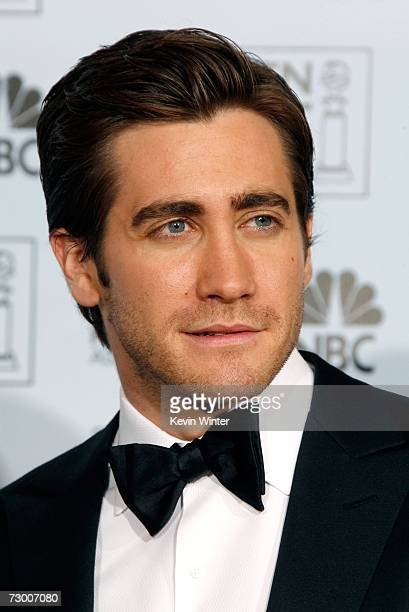 Actor Jake Gyllenhaal poses backstage after presenting writer Peter Morgan with his Best Screenplay Motion Picture award for 'The Queen' during the...
