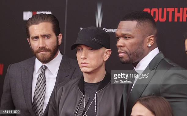 Actor Jake Gyllenhaal rapper Eminem and actor/rapper 50 Cent attend the 'Southpaw' New York premiere at AMC Loews Lincoln Square on July 20 2015 in...