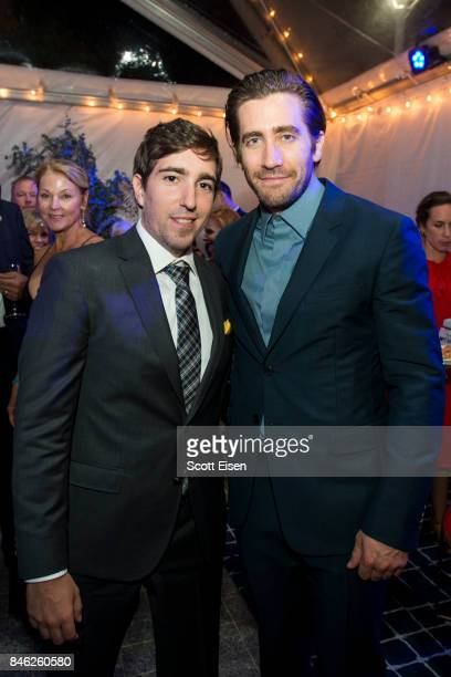 Actor Jake Gyllenhaal right and Boston Marathon bombing survivor Jeff Bauman at the after party following the Boston Premiere of STRONGER at...