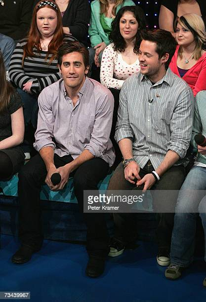 Actor Jake Gyllenhaal sits in the audience with MTV VJ Damien Fahey during MTV's Total Request Live at the MTV Times Square Studios on February 27...