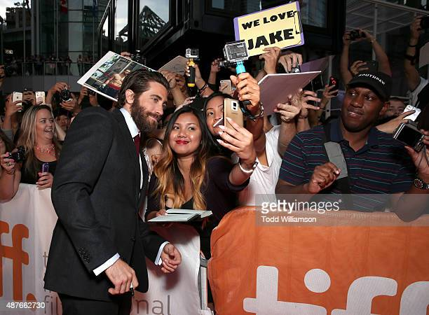 Actor Jake Gyllenhaal takes a selfie with fans at Fox Searchlight's 'Demolition' Toronto International Film Festival gala presentation at Roy Thomson...