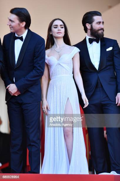 US actor Jake Gyllenhaal US actor Paul Dano and British actress Lily Collins arrive for the screening of the film 'Okja' in competition at the 70th...