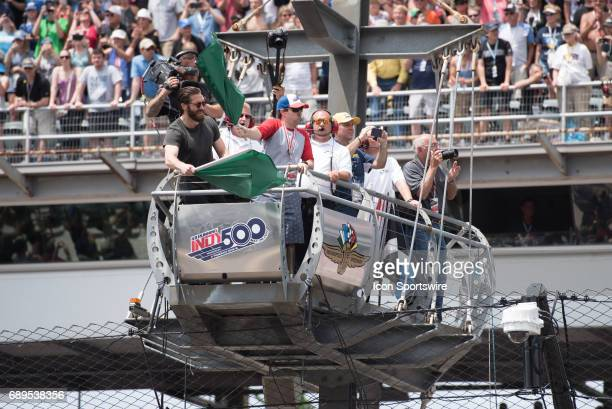 Actor Jake Gyllenhaal with Boston Marathon bombing survivor jeff Bauman waving the green flag for the 101st Indianapolis 500 on May 28 at the...