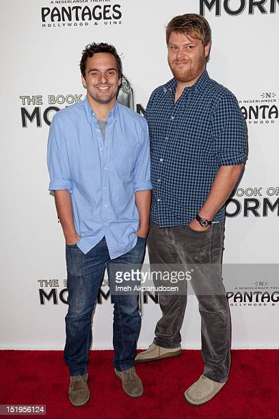 Actor Jake Johnson and guest attend the premiere of 'The Book Of Mormon' at the Pantages Theatre on September 12 2012 in Hollywood California