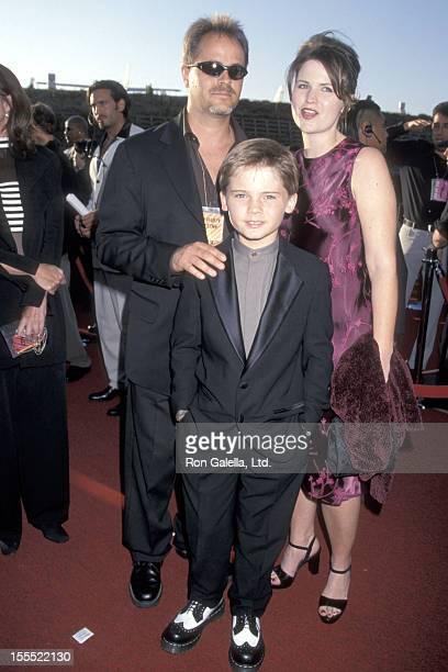 Actor Jake Lloyd and parents Lisa and William Lloyd attend the Eighth Annual MTV Movie Awards on June 5 1999 at The Barker Hangar The Santa Monica...