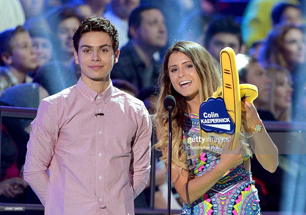 Actor Jake T. Austin (L) and surfer Anastasia Ashley speak onstage during Cartoon Network's fourth annual Hall of Game Awards at Barker Hangar on February 15, 2014 in Santa Monica, California.