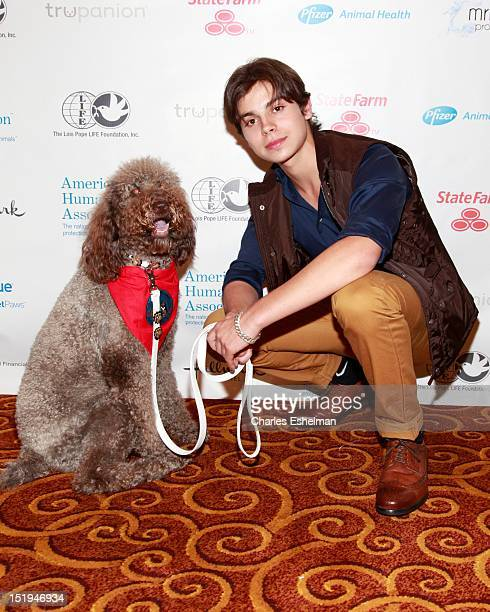 Actor Jake T Austin and Thearpy dog Stella attend American Humane Association 'Superheroes Among Us' Gala at Gotham Hall on September 12 2012 in New...