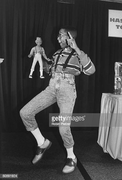 Actor Jaleel White Steve Urkel on the TV show Family Matters dancing w Hasbro's Steve Urkel doll at a promotional show