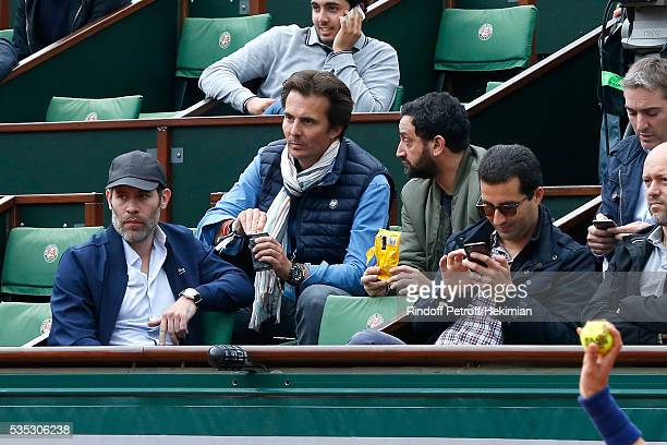 Actor Jalil Lespert Businessman Yannick Bollore and TV Host Cyril Hanouna attend Day Height of the 2016 French Tennis Open at Roland Garros on May 29...