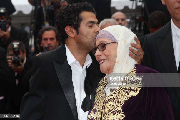 Actor Jamel Debbouze kisses Chafia Boudraa attend the 'Outside Of The Law' Premiere at the Palais des Festivals during the 63rd Annual Cannes Film...