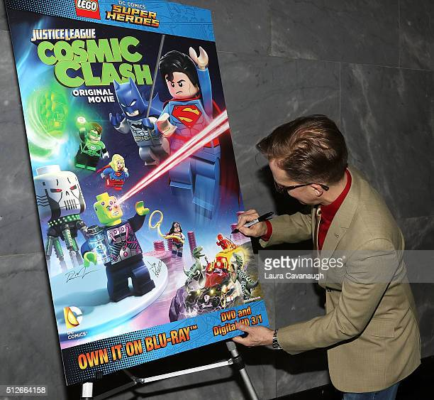 Actor James Arnold Taylor signs a poster at Lego DC Comics Super Heroes Justice League Cosmic Clash at The Paley Center for Media on February 27 2016...