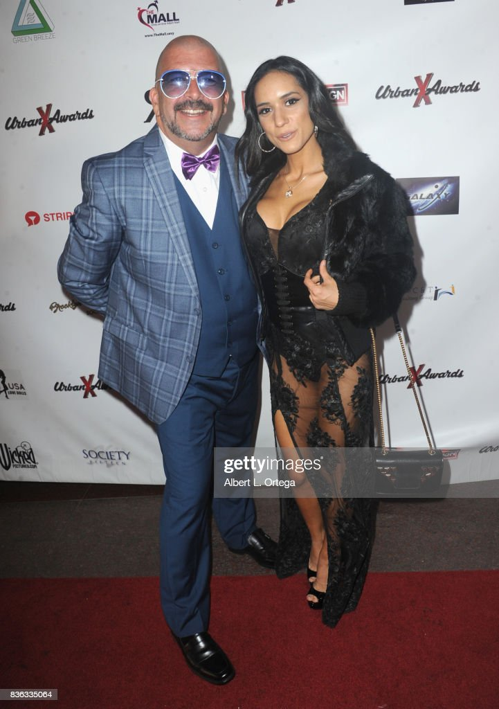 Actor James Bartholet and actress Tia Cyrus arrive for the 6th Urban X Awards held at Stars On Brand on August 20, 2017 in Glendale, California.