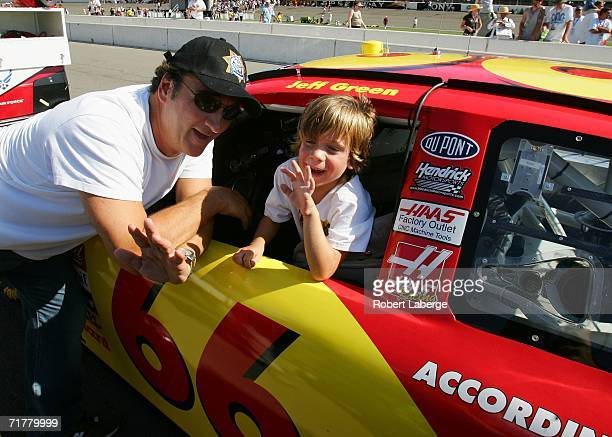 Actor James Belushi and his son Jared visit the car of Jeff Green According to Jim/Best Buy Chevrolet prior to the NASCAR Nextel Cup Series Sony HD...