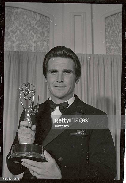 Actor James Brolin holding the Emmy for Best Actor in A Supporting role he won for Marcus Welby MD