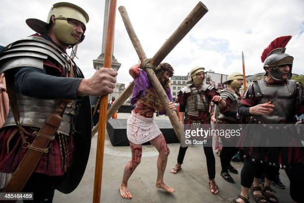 Actor James BurkeDunsmore of the Wintershall Players performs 'The Passion of Jesus' on Good Friday to crowds in Trafalgar Square on April 18 2014 in...