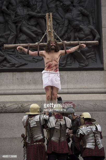 Actor James BurkeDunsmore playing the role of Jesus is 'crucified' on the cross during a performance of Wintershall's 'The Passion of Jesus' on Good...
