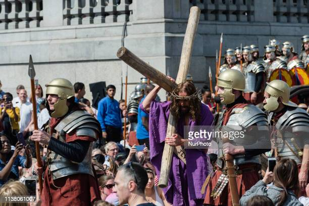 Actor James BurkeDunsmore plays Jesus Christ carries a cross during a Good Friday performance of 'The Passion of Jesus' by Wintershall cast in...