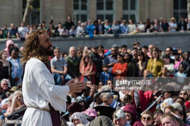 Actor James BurkeDunsmore plays Jesus Christ praying in the Garden of Gethsemane during a Good Friday performance of 'The Passion of Jesus' by...