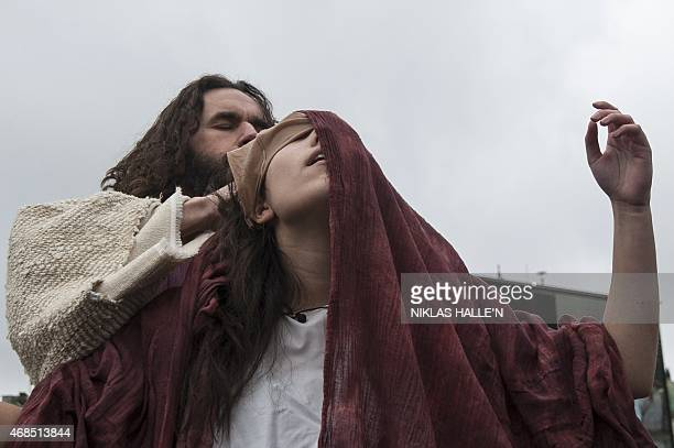 Actor James BurkeDunsmore plays the role of Jesus Christ during a performance of Wintershall's 'The Passion of Jesus' on Good Friday in Trafalgar...
