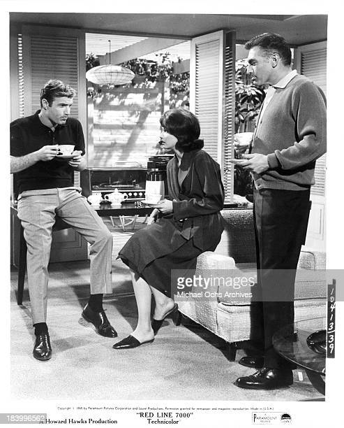 Actor James Caan actress Gail Hire and actor Norman Alden on the set of the Paramount Pictures movie 'Red Line 7000' in 1965