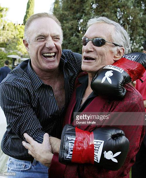 Actor James Caan and Hugh Hefner have a laugh during Fight Night at the Playboy Mansion on July 15 2003 in Bel Air California
