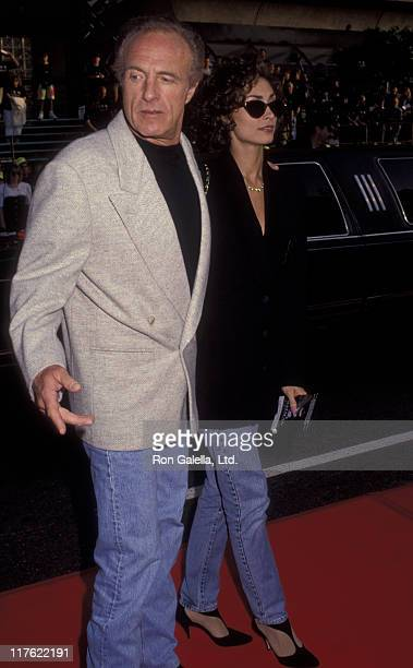 Actor James Caan and Ingrid Hajek attend the premiere of Batman Returns on June 16 1992 at Mann Chinese Theater in Hollywood California