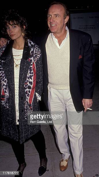 Actor James Caan and Ingrid Hajek attend the premiere of Godfather III on December 20 1990 at the Academy Theater in Beverly Hills California