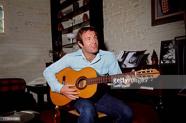 Actor James Caan at home playing a guitar on April 161970 in Hollywood California
