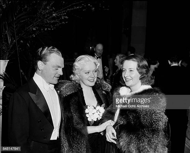 Actor James Cagney with actress Alice Faye and Barbara Stanwyck attend an event in Los Angeles California