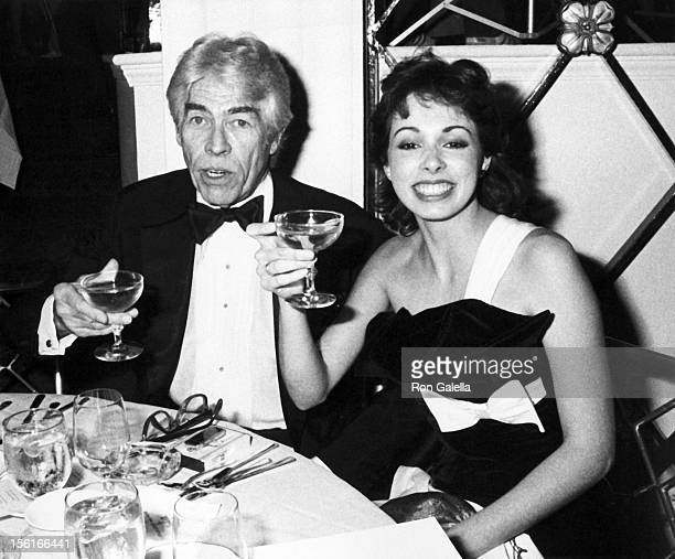Actor James Coburn and date Lisa Alexander attending 'First Annual Operation California Benefit' on February 11 1983 at the Beverly Hills Hotel in...