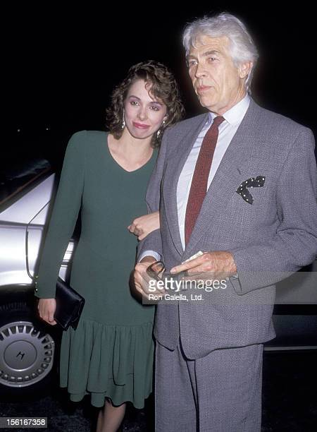 Actor James Coburn and his girlfriend Lisa Alexander on May 26 1987 dining at Spago in West Hollywood California