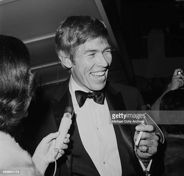 Actor James Coburn is interviewed as he attends a premiere in Los Angeles California