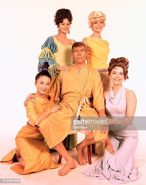 Actor James Coburn surrounded by actresses Shelby Grant Sigrid Valdis Gianna Serra and Helen Funai All are appearing in the movie Our Man Flint