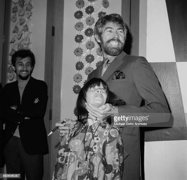 Actor James Coburn with his daughter Lisa attends a premiere in Los Angeles California