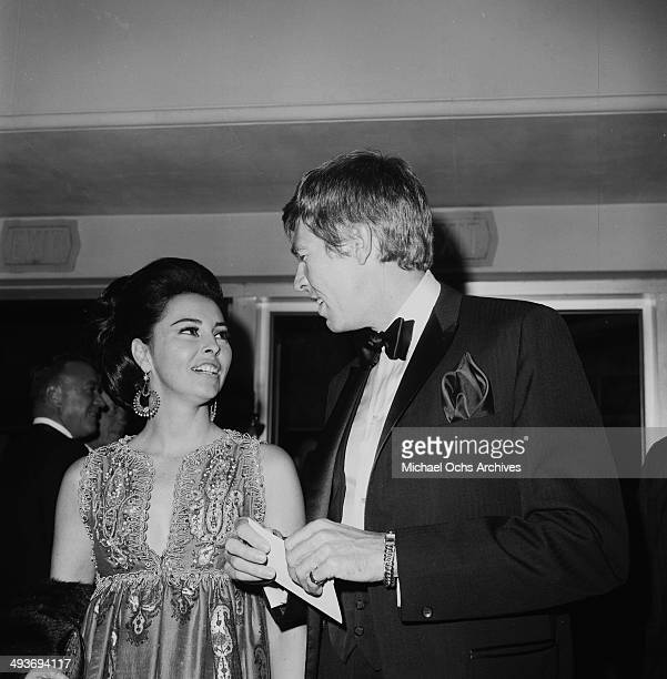 Actor James Coburn with his wife Beverly attend a premiere in Los Angeles California