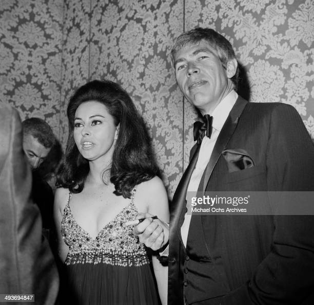 Actor James Coburn with his wife Beverly attends a premiere in Los Angeles California