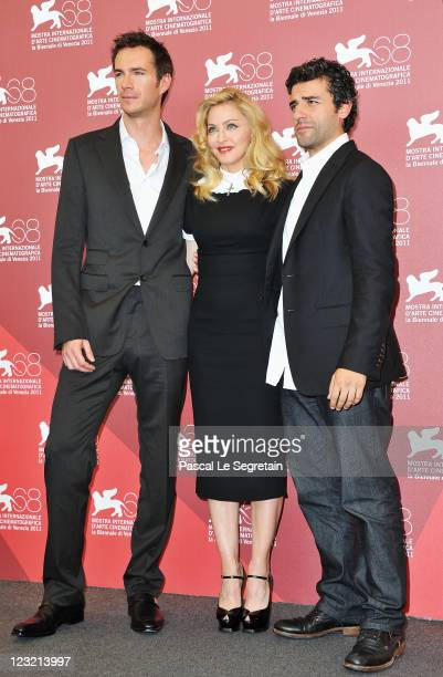 """Actor James D'Arcy, director/writer Madonna and actor Oscar Isaac pose during the""""W.E."""" photocall at the Palazzo Del Cinema during the 68th Venice..."""