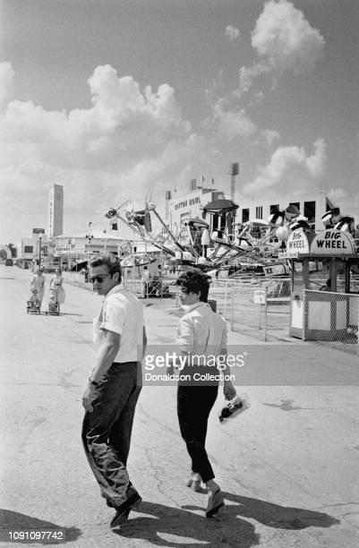 Actor James Dean and actress Elizabeth Tayor attend the Texas State Fairgrounds on a weekend break during the filming of the movie Giant in JULY 4...