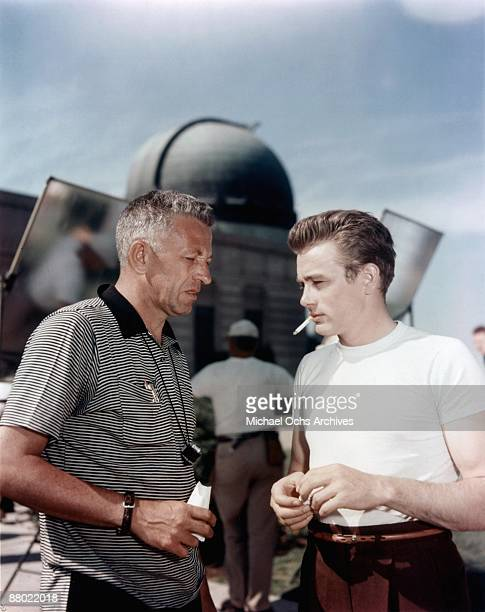 Actor James Dean and director Nicholas Ray discuss a scene from the Warner Bros film 'Rebel Without A Cause' at the Griffith Park Observatory in 1955...