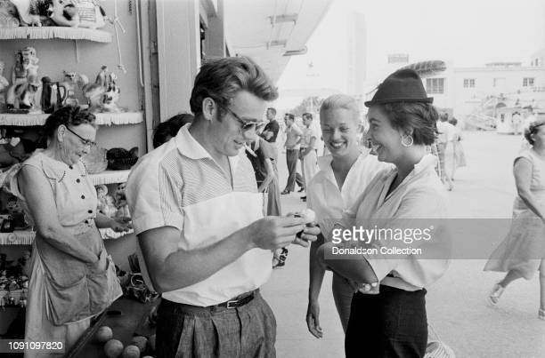 Actor James Dean hair stylist Pat Westmore and actress Elizabeth Tayor attend the Texas State Fair on a weekend break during the filming of the movie...