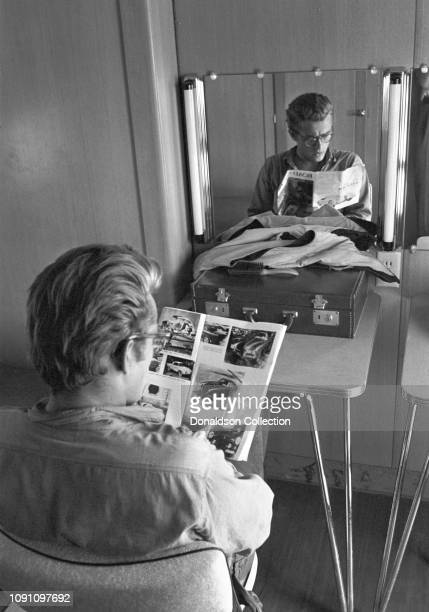 Actor James Dean in his trailer on the set of the movie Giant in October 1955 in Marfa Texas