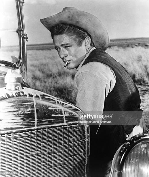 Actor James Dean poses for a photo on the set of the Warner Bros film 'Giant' in 1955 in Marfa Texas