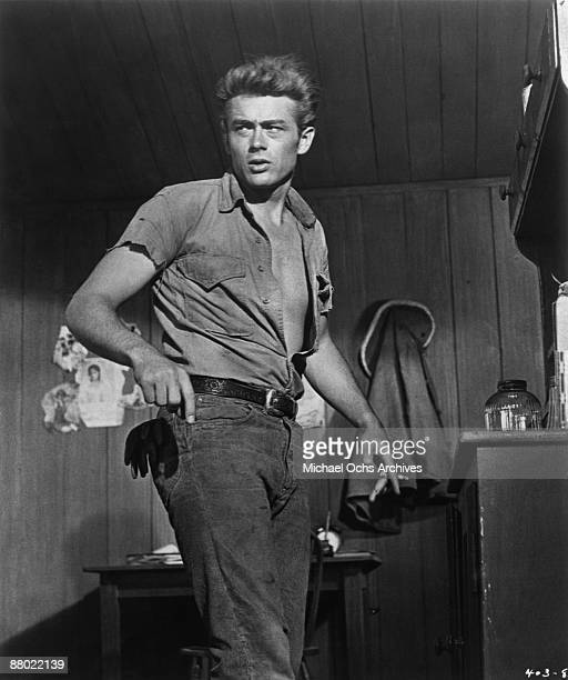 Actor James Dean poses for a photo on the set of the Warner Bros film 'Giant' in 1955 in Los Angeles California